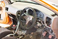 Dettaglio delle vetture da corsa e parte del motore di automobile fotografie stock