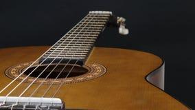 Dettaglio di nylon della chitarra acustica della corda Immagine Stock