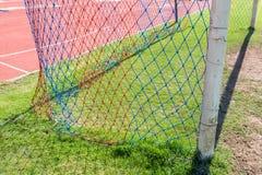 Dettaglio di scopo di calcio con un calcio Immagine Stock