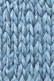 Dettaglio di struttura di Mat Coarse Plaiting Rustic Grunge del posto della fibra della palma dei blu polvere immagine stock