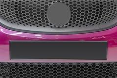 Dettaglio moderno della parte anteriore del veicolo nel tono porpora Piatto dell'automobile fotografia stock libera da diritti