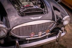 Dettaglio nero della parte anteriore di Austin Healey immagini stock