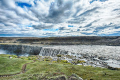 Dettifoss. Is the most powerful waterfall on Iceland and in the whole Europe. It is located in Jokulsargljufur National Park the northeasten Iceland on the royalty free stock photos
