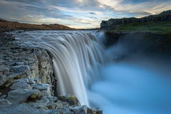 Dettifoss. Situated in Vatnajökul N.P. in Northeast Iceland, it's the most powerful waterfall in Europe. Photo taken from the east bank at sunset royalty free stock images