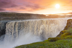 Dettifoss. Sunset over, Dettifoss the most powerful waterfall on Iceland and in the whole Europe. It is located in Jokulsargljufur National Park the northeasten stock photo