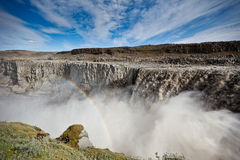 Dettifoss Waterfall in Iceland. Under a blue summer sky with clouds. Horizontal shot royalty free stock photography