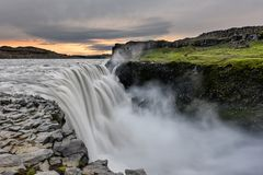 Dettifoss is a waterfall in Vatnajokull National Park in Iceland, and is the most powerful waterfall in Europe. Amazing landscape at sunrise stock photos