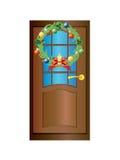 deur met een kroon van Kerstmis Royalty-vrije Stock Foto's