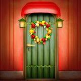 Deur met Kerstmiskroon royalty-vrije stock afbeeldingen