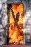 Deur in vlammen Stock Foto's