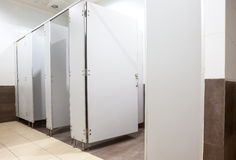 Deuren van toiletten Stock Foto's