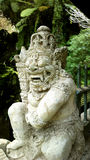 Deus do Balinese (pedra) Imagem de Stock