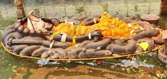 Deus hindu Vishnu Lies em uma posição de reclinação fotografia de stock royalty free