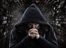 Bandido Praying imagens de stock