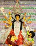 Deusa Durga que senta-se no leão imagem de stock royalty free