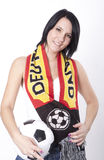 Deutchland fan. Girl wearing a scarf of Deutchland and holding football Stock Images