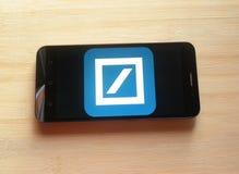 Deutsche Bank app on mobile phone. Deutsche Bank app on smartphone kept on wooden table royalty free stock photos