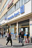 Deutsche Bank, Germany. BERLIN, GERMANY - AUGUST 27, 2014: People walk by Deutsche Bank branch in Berlin. Deutsche Bank is one of largest banks in the world with stock image