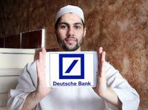 Deutsche bank logo. Logo of deutsche bank on samsung tablet holded by arab muslim man stock photography