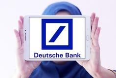 Deutsche bank logo. Logo of deutsche bank on samsung tablet holded by arab muslim woman stock photo