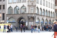 Deutsche Bank in Munich with Shoppers. Munich, Bavaria / Germany - April 16 2019: Deutsche Bank front entrance with logo, atm, and people in Munich Germany royalty free stock photos