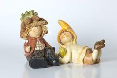 Deutsche Spielzeugzwerge der Weinlese mit Mais Stockbild