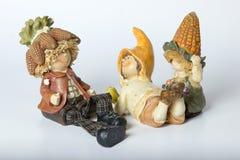 Deutsche Spielzeugzwerge der Weinlese mit Mais Stockfotos