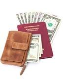 Deutscher Pass mit Dollaranmerkungen und -geldbörse Stockfotos