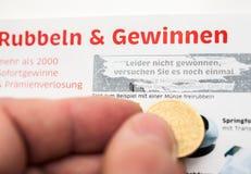 Deutsches Lottoscheinverkratzen Stockfotografie
