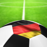 Deutschland Flag Pattern of a soccer ball in green grass. Stock Photos