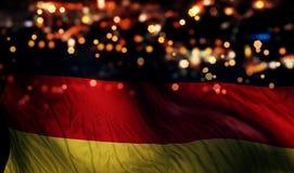 Deutschland-Staatsflagge-Licht-Nacht-Bokeh-Zusammenfassungs-Hintergrund Lizenzfreies Stockbild