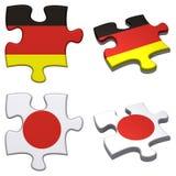Deutschland-u. Japan-Puzzlespiel lizenzfreie abbildung