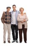Deux aînés et un jeune homme posant ensemble Photos libres de droits