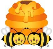 Deux abeilles mignonnes avec la ruche illustration libre de droits