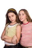 Deux adolescentes d'isolement sur le blanc Photo libre de droits