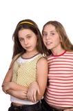 Deux adolescentes d'isolement sur le blanc Photo libre de droits