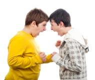 Deux adolescents criant à l'un l'autre Photo stock