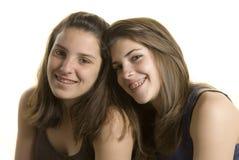 Deux amies sur un projectile de studio Photos libres de droits