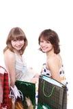 Deux amis heureux avec des achats Photo stock