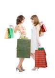 Deux amis heureux avec des achats. Photo libre de droits