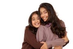 Deux amis indiens d'isolement sur le blanc Photographie stock libre de droits