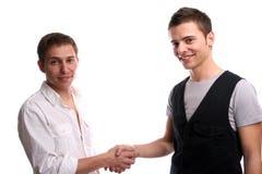 Deux amis se serrant la main Photos libres de droits