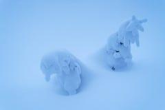 Deux arbres de Noël dans la neige Photographie stock libre de droits