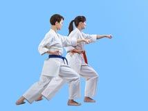 Deux athlètes de filles battent le bras de poinçon Image stock