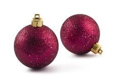 Deux babioles rouges de Noël Photo stock