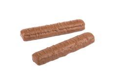Deux barres de chocolat d'isolement Photographie stock