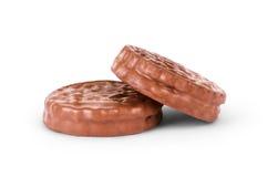 Deux biscuits de chocolat sur le fond blanc Image libre de droits