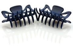 Deux bornes de cheveu bleu-foncé, d'isolement Images stock
