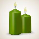 Deux bougies vertes brûlantes de vecteur d'isolement Photographie stock