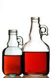 Deux bouteilles avec le fond blanc Photo libre de droits